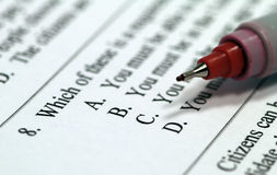 Taking a test. With red pen Royalty Free Stock Photo