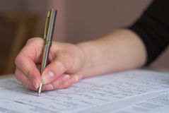 Taking test. Student is taking test in math. Fingers in focus royalty free stock photography
