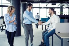 Taking their business on the move. Full length of young modern people in smart casual wear having a discussion while royalty free stock photo