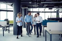 Taking their business on the move. Full length of young modern people in smart casual wear having a discussion while stock image