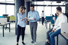 Taking their business on the move. Full length of young modern people in smart casual wear having a discussion while stock photos