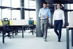 Taking their business on the move. Full length of young modern people in smart casual wear having a discussion while stock photo