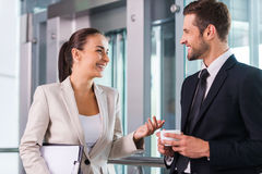 Taking time to chat with colleague. Royalty Free Stock Image