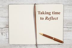 Free Taking Time To Reflect On Brown Journal With Pen On A Weathered Whitewash Wood Stock Photography - 158766322