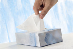 Taking a tissue Royalty Free Stock Photography