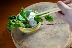 Taking tofu with chopstick in bowl Royalty Free Stock Photos