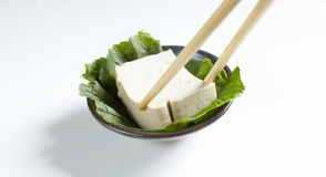 Taking tofu with chopstick Royalty Free Stock Photography