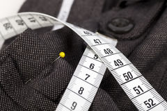Taking Trousers In. Measuring tape and trousers about to be altered Royalty Free Stock Images