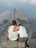 Taking in the View. Hikers taking in Half Dome at Yosemite National Park stock images