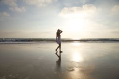 Taking a walk on golden beach Stock Photo