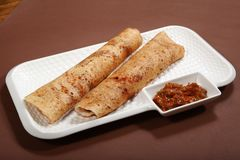 Takkali Chutney Dosa, Dosa with Tomato Chutney, Rice Pancake with tomato salsa royalty free stock image
