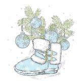 Takken van een Kerstboom in Nieuwjaar` s laarzen Nieuwjaar ` s en Kerstmis De winter Stock Fotografie