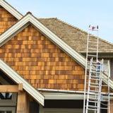 taklägga siding för home hus Arkivfoton
