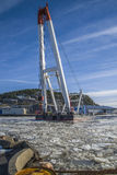 Taklift dock at the port of halden. Taklift, a giant seagoing crane with a lifting capacity of up to 400 tons at 45 meters dock at the port of Halden, the image Stock Image