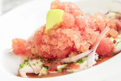 Tako Ceviche. Poached octopus with jalapeno cucumber brunoise and red onion shavings, topped with tomato granite and frozen olive oil Stock Photography