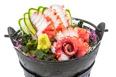 Tako Octopus sashimi. Tako sashimi, fresh raw Octopus in Japanese cuisine serve on the ice with wasabi and seaweed isolated on white background stock images