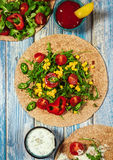 Tako tortillas with corn, cherry tomatoes and sauces Stock Image