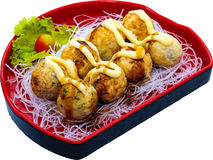Takoyaki. The Isolation japanese traditonal food in the decorated container royalty free stock images