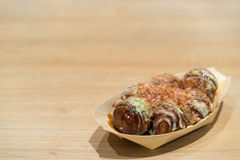 Takoyaki (octopus balls) on paper boat with clipping path, copy space on wood table background Royalty Free Stock Photography