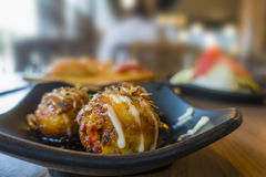 Takoyaki on table Royalty Free Stock Image