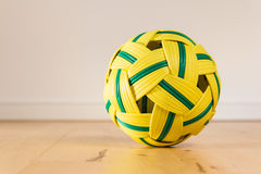 Takraw ball on wood floor Stock Photography