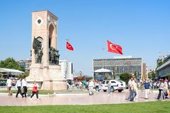 Taksim Square. People walk around Republic Monument at Taksim Square on July 06, 2010 in Istanbul. The monument honoring the leaders of the struggle for Stock Photo
