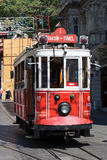 Taksim Tunel Nostalgia Tram trundles along the istiklal street and people at istiklal avenue. Istanbul, Turkey Stock Images