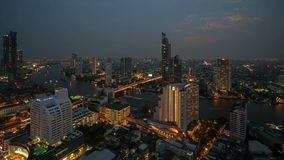 Taksin Bridge at Chao Phraya River in Bangkok City, Thailand. Day to Night Time lapse.  stock video footage