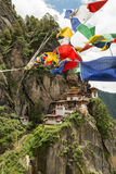 Taktsang Palphug Monastery with prayer flag (also known as The Tiger nest temple), Paro, Bhutan Stock Photos