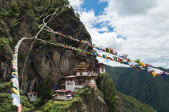 Taktsang Palphug Monastery with prayer flag (also known as The Tiger nest temple), Paro, Bhutan Royalty Free Stock Image