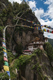 Taktsang Palphug Monastery with prayer flag (also known as The Tiger nest temple), Paro, Bhutan Royalty Free Stock Photography