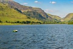 Tal-y-Llyn, Wales, UK. A boat on the Tal-y-Llyn in South Snowdonia, Gwynedd, Wales, UK - with Cadair Idris in the background Royalty Free Stock Image