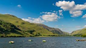 Tal-y-Llyn, Wales, UK. Boats on the Tal-y-Llyn in South Snowdonia, Gwynedd, Wales, UK - with Cadair Idris in the background Stock Photo