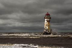 Talacre Lighthouse. Captured in windy conditions as a storn was heading in. Talacre Lighthouse located in Flintshire, North Wales was , built in 1776 became Royalty Free Stock Photo