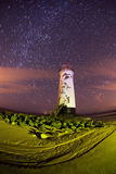 Talacre lighthouse at night with star trails Royalty Free Stock Images