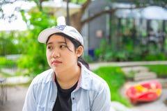 Taladro adolescente asiático infeliz de la expresión Foto de archivo libre de regalías