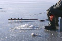 Taladro del hielo y caña de pescar del hielo Imagen de archivo libre de regalías