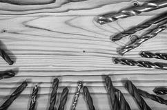 Taladros en una tabla de madera Fotos de archivo libres de regalías
