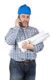 talande arbetare för konstruktionstelefon Arkivbild