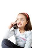 talande barn för flickatelefon Royaltyfria Foton