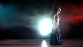 Talanted belly dancer in a blue stage costume stock footage