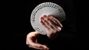 Talanted magician showing his trick with cards stock footage