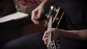 Talanted musician is playing on a bass guitar in a professional recornding studio. Talanted musician is playing on a bass guitar in a professional recording stock video