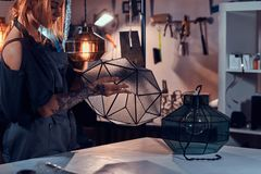Talanted designer with her new lamp project royalty free stock images