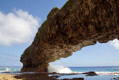 Talava arch. The sea has eroded the coral rock to form this archway Royalty Free Stock Images
