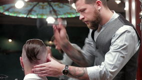 Talc usage in modern hairstyle. In barbershop stock video footage
