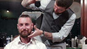 Talc usage in modern hairstyle. In barbershop stock video