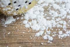 Talcum powder. Closeup white talcum powder on wooden background stock photography