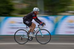 TALDYKORGAN, KAZAKHSTAN - MAY 21, 2017: An elderly male athlete rides a road bike stock photos