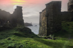 Tale landscape. Unnatural sunrise between the old ruins in France Stock Images